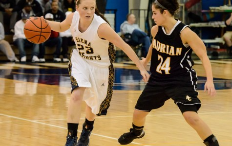 SHU junior Grace Howrigon keeps the ball away from Adrian College's Nicole Boggs (Photo Courtesy of SHU Marketing).