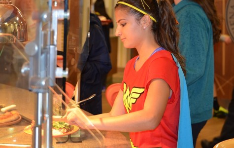 Lucia Alfaro picks her food out from one of many stations in the McLaughlin Dining Center (Photo by Ryan Dukes)
