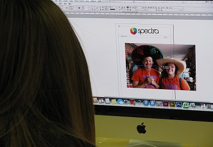 Junior Amanda Shawver works on a project in inDesign for her journalism class. (Photo Spectra Staff)